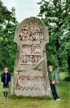 Picture of a rune stone and two children