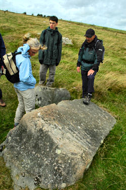 Picture of walkers looking at the stone