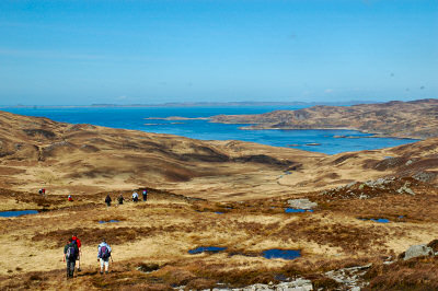 Picture of walkers approaching Loch Tarbert on the Isle of Jura